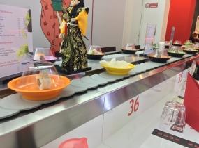 Sushi on the conveyor belt. Photo by Allison Boyd, Marist Italy MA 2013-14